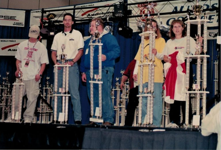 Rick Berry on stage with 4th place trophy